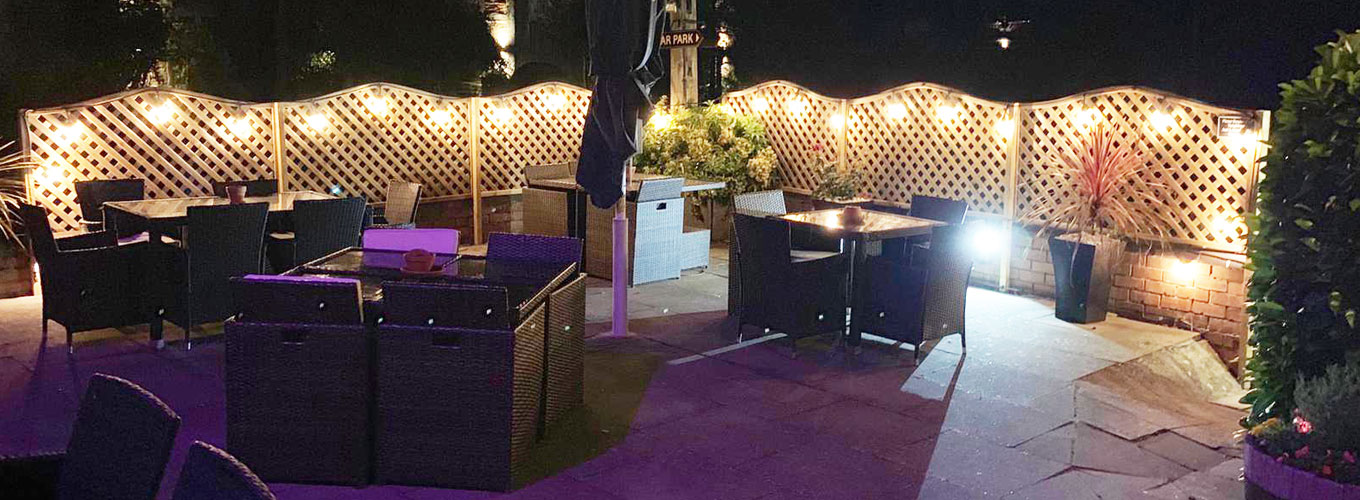 The Crown Claverdon - Seating Area at Night